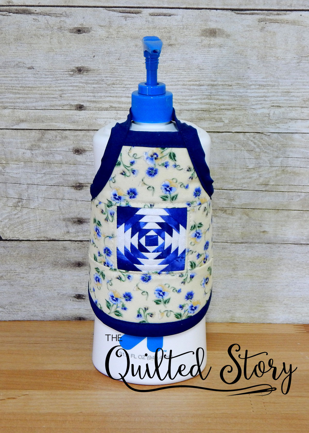 paper pieced lotion bottle apron